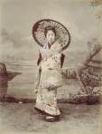 A girl in a kimono and  Japanese  parasol.